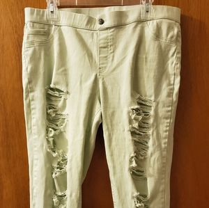 Mint green ripped skinny jeans